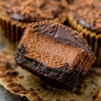 These rich and creamy Mini Chocolate Cheesecakes are made in a muffin pan! So easy and perfect for serving a crowd.
