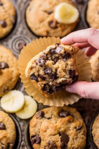 Healthy Banana Muffins are moist, fluffy, and so sweet! A handful of chocolate chips makes them a little indulgent, without going overboard. Made with honey, whole wheat flour, and protein packed Greek yogurt, these are perfect for breakfast or as an afternoon snack. This is a great recipe you'll want to use over and over again!