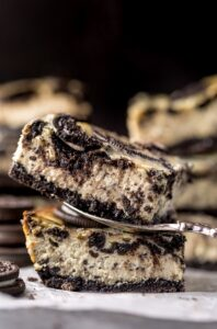 The Best Oreo Cheesecake Bars! So thick and creamy! #oreo #cheesecake #cheesecakebars #oreodesserts