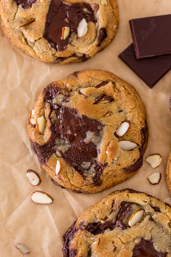 Thick and chewy Almond Amaretto Chocolate Chunk Cookies! These are so flavorful and one of the BEST cookie recipes we've ever made. If you love almonds and chocolate, you have to try them!