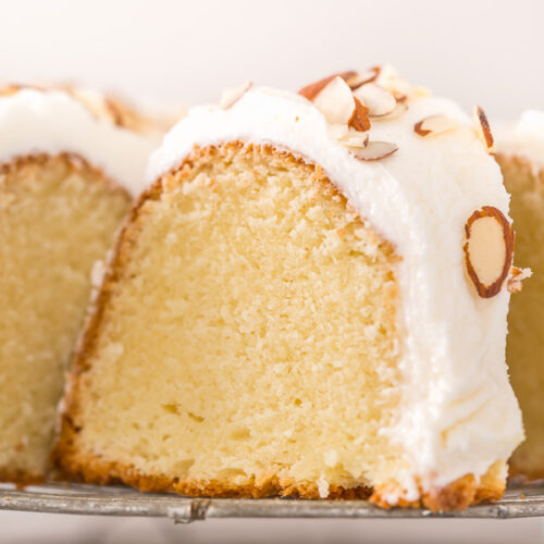 This Almond Amaretto Pound Cake is moist, buttery, and so flavorful! Topped with homemade Almond and Amaretto Cream Cheese Frosting and Slivered Almonds, it's a total showstopper, too. Perfect for any celebration!
