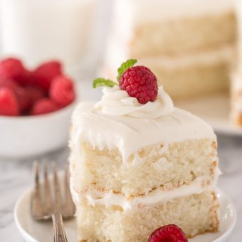 This is the BEST white cake recipe you'll ever bake! Each slice is moist, fluffy, and so delicious. This tender snow-white cake is made completely from scratch and with simple ingredients!