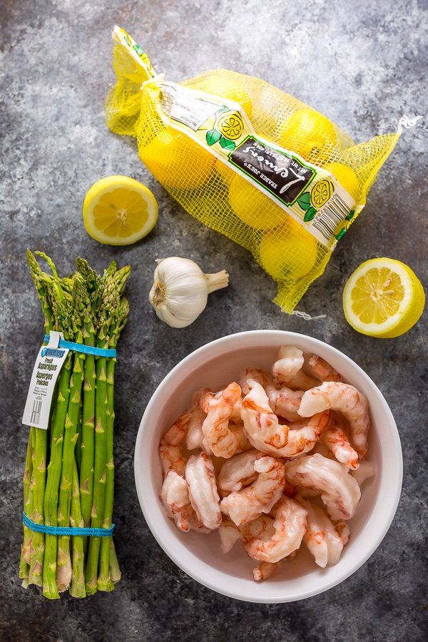 This quick and easy Lemon Garlic Shrimp and Asparagus is ready in less than 20 minutes! This one pan meal is exploding with flavor and always a crowd-pleaser. So next time you're looking for a healthy dinner, give this garlic shrimp and asparagus a try!