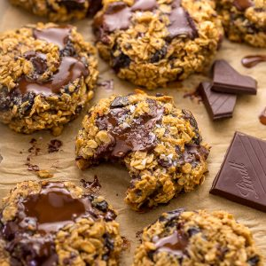 These Gluten Free Oatmeal Cookies are soft yet crunchy and loaded with gooey chocolate! Made with gluten free oats, almond flour, and shredded coconut, these cookies are completely gluten free. So delicious with a glass of milk!