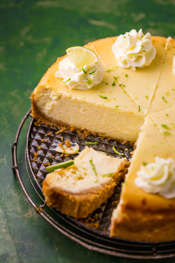 This Key Lime Cheesecake is so creamy and always a crowd-pleaser! The base is a graham cracker crust and the cheesecake filling is made with lime juice and lime zest, which provides plenty of lime flavor. If you love key lime pie and cheesecake, you have to try this great recipe!