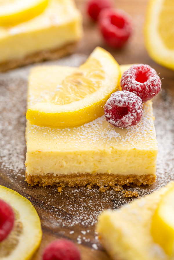 These Lemon Pie Bars are made with lemon juice, lemon zest, and lemon extract, so you know they're loaded with lemon flavor! Sprinkle each bar with powdered sugar and serve with fresh raspberries. Anyone who loves lemon should try this easy lemon dessert!!!