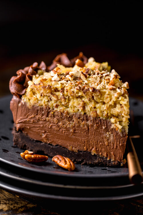 This No-Bake German Chocolate Cheesecake is insanely decadent and such a treat! Featuring a crunchy Oreo cookie crust, creamy chocolate cheesecake filling, and coconut and pecan topping... it's a total showstopper! Bonus: You can make this up to 4 days in advance!