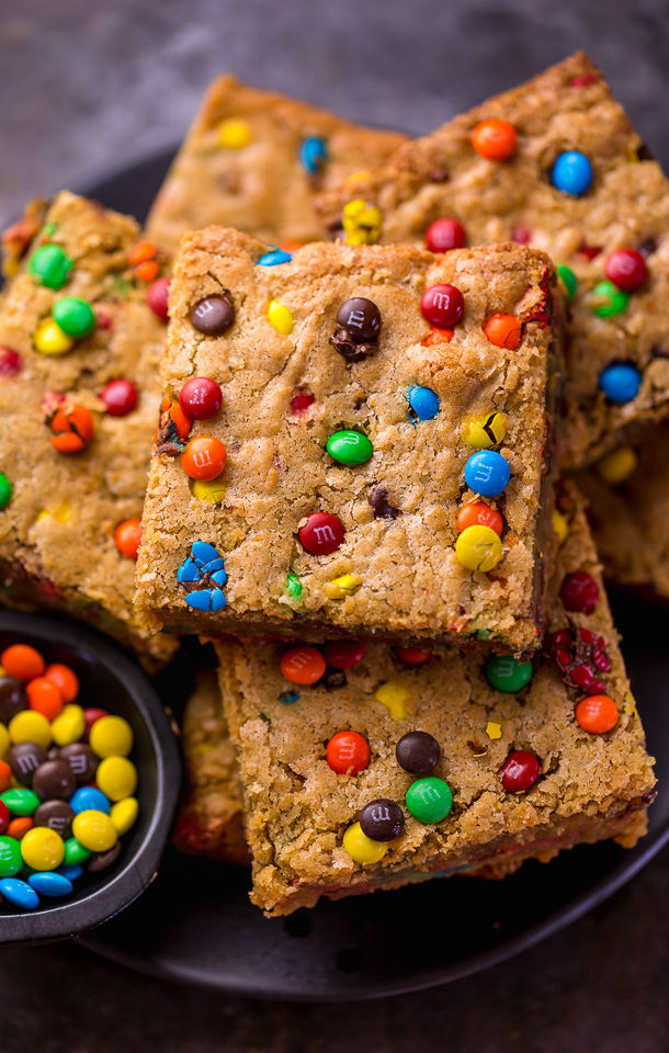 Easy M&M Cookie Bars are soft, chewy, and so delicious! Loved by kids and adults, these are perfect for bake sales, potlucks, and holiday baking! Just like my brown butter M&M cookies, but so much easier!