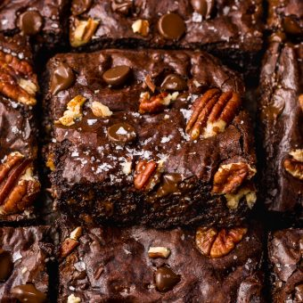 These Bourbon Pecan Brownies are going to blow your mind! They're thick, insanely chewy, and loaded with crunchy pecans, a pinch of cinnamon, and flavorful bourbon! The ultimate special occasion brownie recipe!