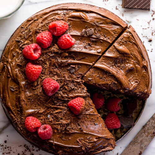 This Easy Single Layer Chocolate Cake is utterly moist and topped with melt-in-your-mouth Chocolate Frosting! The perfect dessert for date night in, small birthday celebrations, and intimate gatherings. And no electric mixer required!