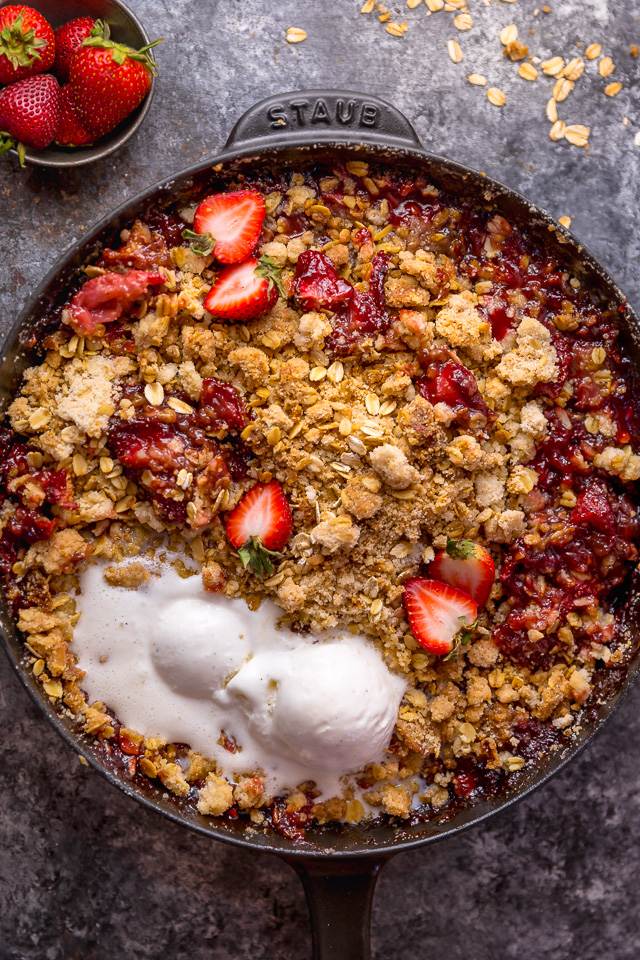 This Easy Strawberry Crisp is the perfect Summer dessert! Featuring plenty of juicy strawberries and a golden brown oatmeal crisp topping, it's best served warm... with a big scoop of vanilla ice cream on top! Can be made with fresh or frozen strawberries!