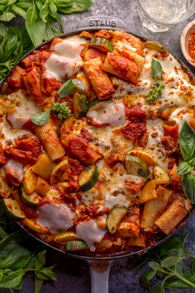 Preheat your oven to 350, because we're making Baked Rigatoni Fra Diavolo with Sausage and Zucchini for dinner tonight! Featuring a spicy tomato sauce loaded with fresh herbs, Italian sausage, tender zucchini, and tons of gooey cheese! This is Summer comfort food at its best!