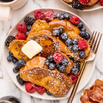 Today I'm teaching you how to make the BEST Easy French Toast! And you won't believe how quick and easy it is! Topped with fresh berries, powdered sugar, and maple syrup, this is sure to become one of your favorite breakfasts!
