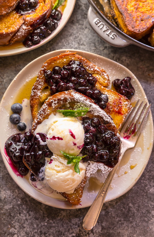 Buttery slices of brioche bread and fresh blueberry maple syrup make this recipe a total showstopper! While it's a little more work than most breakfast casseroles, it's totally worth it! This Brioche French Toast with Blueberry Compote is a great recipe for a lazy Saturday, Christmas morning, or anytime you want to make breakfast extra special! #frenchtoast #blueberrycompote #brioche #briochefrenchtoast #breakfast