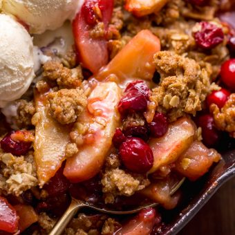 If you love cranberries and apples, you have to try this Easy Apple Cranberry Crisp! Featuring juicy apples, tart cranberries, and a buttery oat crumble topping! Use fresh cranberries or frozen cranberries... both work great! Perfect for Thanksgiving or Christmas dessert!