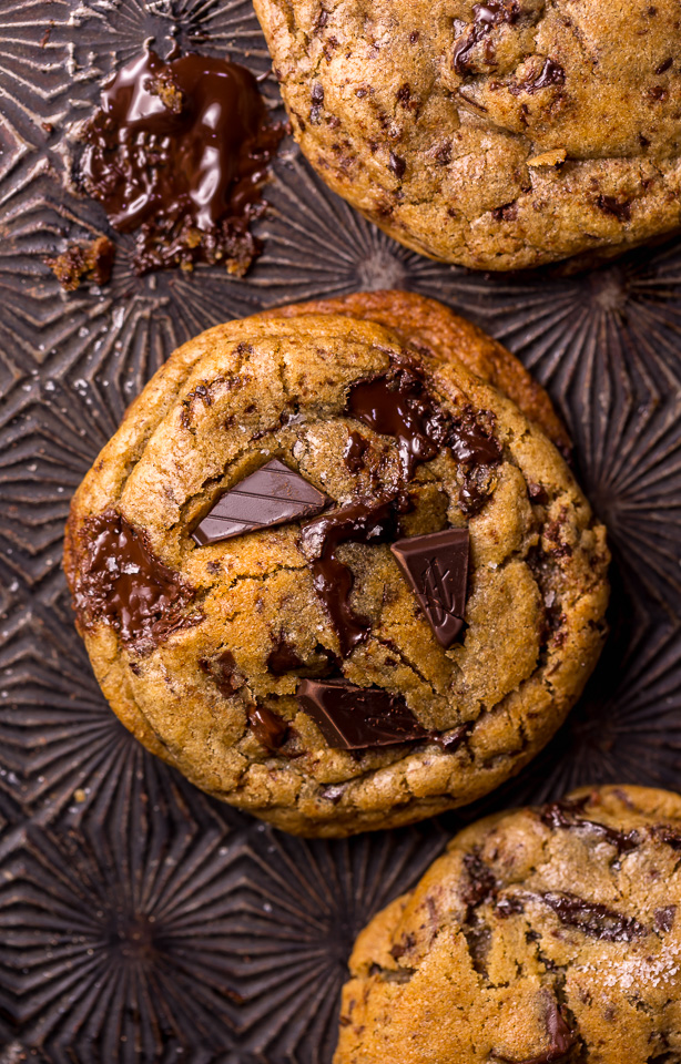 Whiskey lovers will go crazy for these Rye Whiskey Chocolate Chip Cookies! Made with a unique combination of rye flour and all purpose flour, they bake up soft, chewy, and ultra thick! Brown butter, rye whiskey, and plenty of chocolate make these grown up chocolate chip cookies totally irresistible!