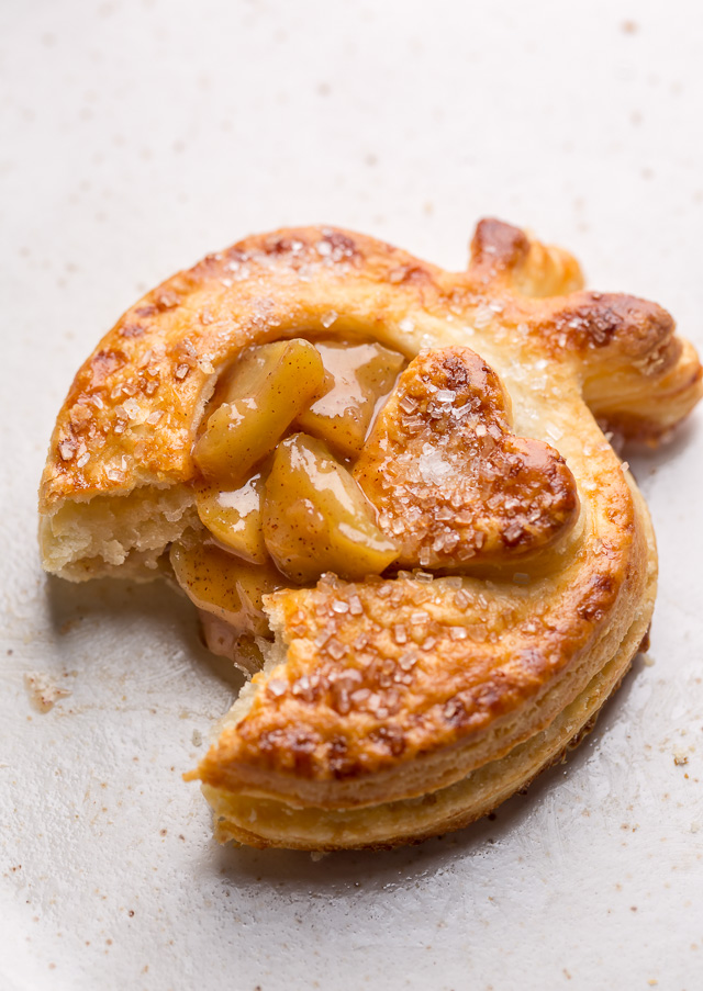 The only thing better than apple pie is cute little apple hand pies!!! Featuring apple shaped homemade pie crust and gooey apple pie filling, these individual apple pies bake up in about 15 minutes! The perfect apple hand pies to for share with loved ones this holiday season.