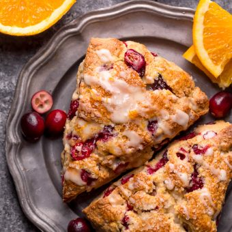 Cranberry Orange Scones are loaded with vibrant orange flavor, fresh cranberries, and topped with a sweet orange glaze! Perfect for breakfast or brunch! And one of my favorite scone recipes to make during the holiday season!