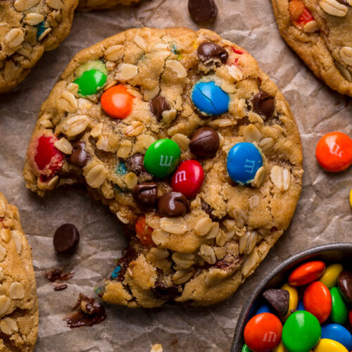 Monster cookies are loaded with creamy peanut butter, chewy oats, colorful m&ms, and gooey chocolate chips! They bake up super thick, with chewy edges and incredibly soft centers. A must try for all of my fellow cookie monsters out there!