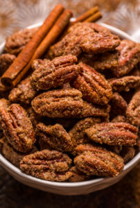 These EASY Candied Pecans are sweet, crunchy, and borderline addictive! Made with simple ingredients, these candied nuts are delicious on salads, ice cream, yogurt, casseroles, or just by the handful! Store in an airtight container and they'll last up to two weeks!