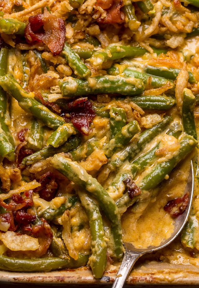 Cheesy Bacon and Green Bean Casserole is creamy, crunchy, and so delicious! Always a huge hit at Thanksgiving celebrations, parties, and pot lucks! If you've been looking for a new green bean casserole recipe, this is it!
