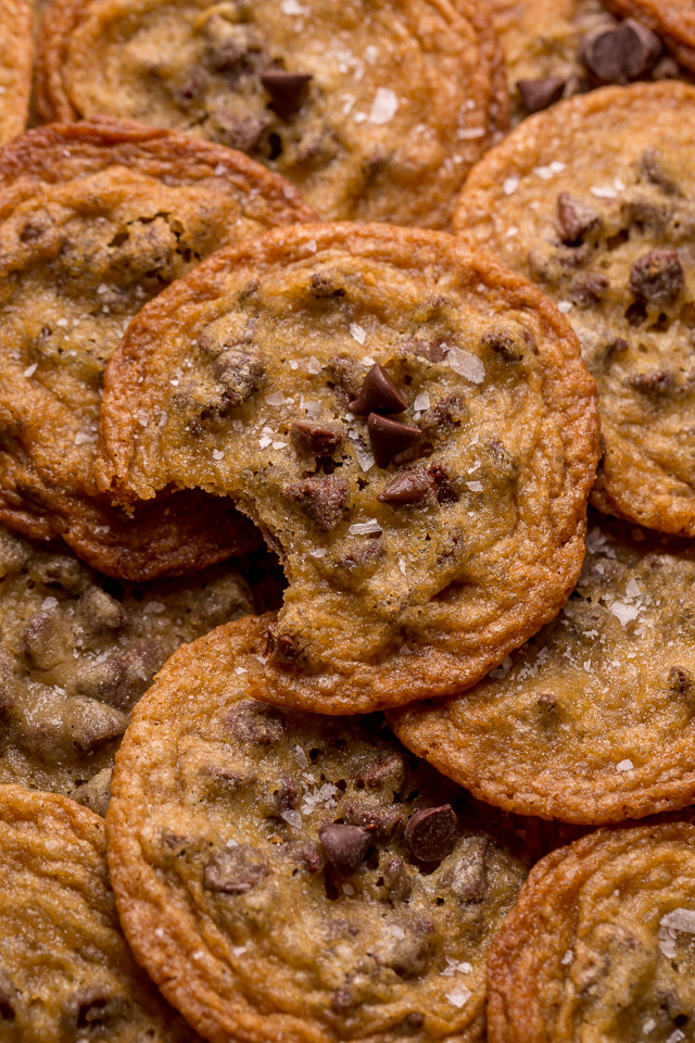 Bust out your cookie sheet, because these thin crispy chocolate chip cookies are a must bake! These cookies bake up golden brown and smell like heaven! Super thin and delightful crisp, these are one of our favorite chocolate chip cookie recipes!