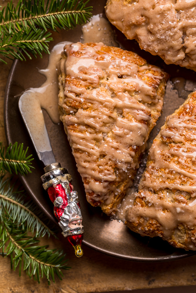 These Bakery-Style Eggnog Scones are flaky, buttery, and loaded with eggnog flavor! Topped with a sweet eggnog glaze, they're perfect for Christmas morning! Best served warm, with a cup of coffee or tea!