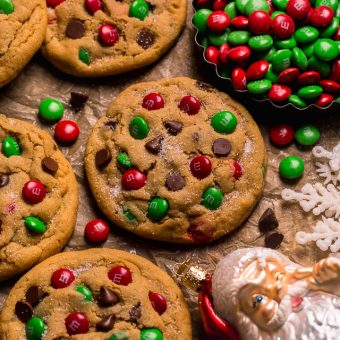 Santa's Favorite Peanut Butter M&M Cookies are thick, soft, and chewy! These GIANT bakery-style holiday cookies are loaded with peanut butter, M&Ms, and gooey milk chocolate chips! A crowd-pleasing cookie recipe that's loved equally by kiddos and adults!