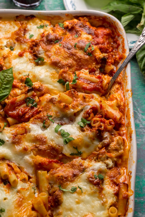 My Best Ever Baked Ziti Recipe serves a crowd and is sure to receive rave reviews! Today I'm spilling my secrets on how to master this classic pasta dish and make it better than you ever have before. Including how to achieve perfectly cooked noodles, make delicious homemade sauce, get golden brown gooey cheese pockets, and so much more.