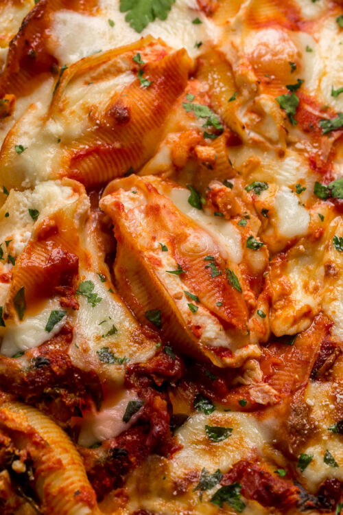 These Crazy Good Classic Stuffed Shells are creamy, gooey, carb-y comfort food at it's best! This family loved recipe features perfectly cooked shells, flavorful tomato sauce, and the most delicious ricotta filling! Sure to become one of your favorite pasta dishes!