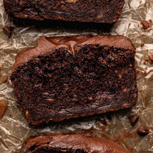 This Extra Moist Chocolate Banana Cake is topped with Espresso Chocolate Ganache! Baked in a load pan, this is a great snacking cake! A great recipe for the when you have ripe bananas and want to bake something other than banana bread!