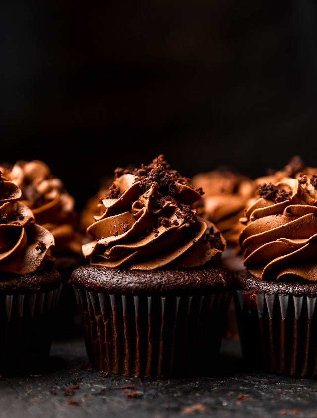 The Best Brooklyn Blackout Cupcakes are insanely moist, filled with chocolate pudding, and topped with fudgy chocolate frosting and chocolate cake crumbs! Just like Brooklyn Blackout Cake... but in cupcake form! These require a little advance planning, but are sure to be a showstopper at your next event!