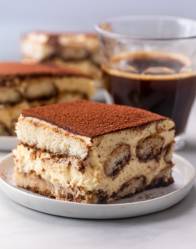 This Classic Italian Tiramisu for a Crowd is always a hit! Made with a creamy mascarpone mixture, coffee soaked ladyfingers, and a dusting of dark cocoa powder, this is heaven in a baking dish! No raw eggs in this recipe!