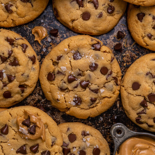 These Bakery-Style Chocolate Chip Cookies are super thick, rich in peanut butter flavor, and loaded with gooey chocolate chips! Press extra chocolate chips on top and sprinkle with sea salt for an impressive presentation! A great recipe for anyone who loves the combination of chocolate and peanut butter!