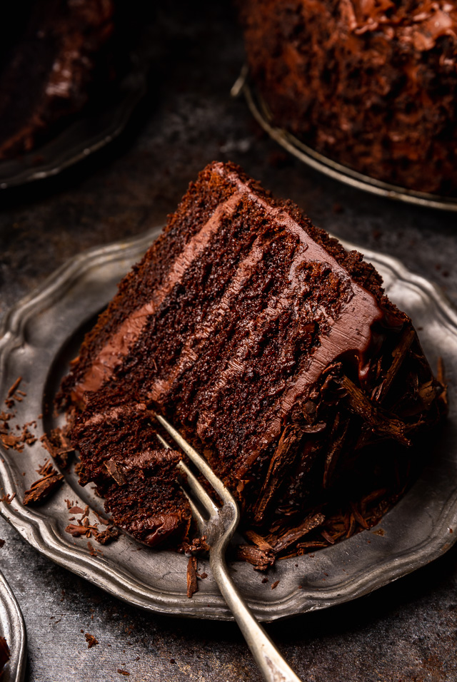 If you love chocolate cake, you have to try this sinfully delicious recipe for Devil's Food Cake! It's an old-fashioned recipe that's intensely rich, moist yet dense, and totally decadent! Exploding with rich chocolate flavor and covered in chocolate frosting, it's sure to become your favorite chocolate cake recipe!