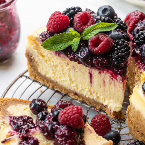 One of my favorite Easter traditions is baking a creamy ricotta cheesecake for my family! It's the perfect recipe to share with a crowd, and it's make-ahead friendly, meaning you can bake it well in advance and just pull it out of the freezer the night before you plan on serving it! Delicious on it's own, but outrageously good with a fresh berry sauce on top!