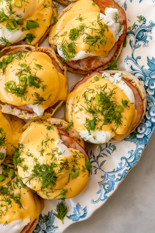 Featuring golden brown toasted English muffins, poached eggs, slices of Canadian bacon, and hollandaise sauce, this Eggs Benedict recipe is pure perfection! Top with freshly chopped dill and scallions, or simply serve with salt and pepper. Perfect for any special at-home breakfast or brunch!