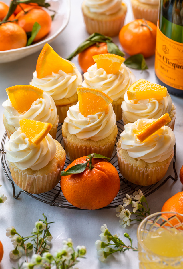 Today I'm teaching you how to make Mimosa Cupcakes! Light and fluffy, these delicious cupcakes are made with freshly squeezed orange juice, orange zest, and of course, CHAMPAGNE! One of my favorite cupcake recipes for brunch or special occasions like Easter, Mother's Day, or New Year's Eve!