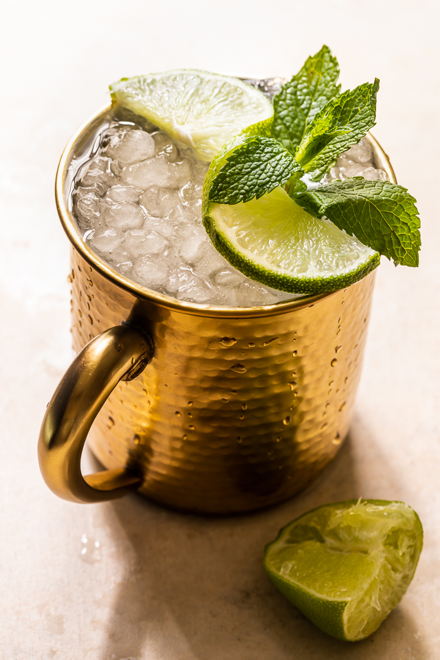 The Best Moscow Mule Recipe features spicy ginger beer, fresh lime juice, vodka, and a ginger lime simple syrup! On a hot Summer day, this refreshing cocktail really hits the spot! For an extra pretty presentation, serve in a copper mug with a sprig of mint and a lime wedge or spiral!