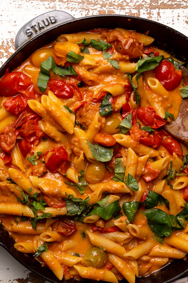 Fresh Tomato Basil Penne alla Vodka is rich, creamy, and so flavorful! The vodka sauce is made with olive oil, a bounty of fresh cherry tomatoes, plenty of garlic, and just a touch of crushed red pepper flakes - plus vodka, cream, and tons of fresh basil! This restaurant quality penne alla vodka recipe is sure to become a family favorite!