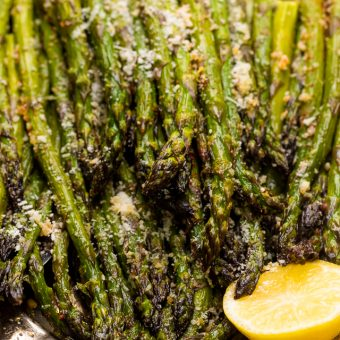 This Lemon Garlic Parmesan Asparagus is a quick and easy side dish that's ready in less than 20 minutes! Perfect with grilled meat, seafood, or a ball of burrata and some charred bread! No matter what you serve it with, I just know you're going to love this recipe!