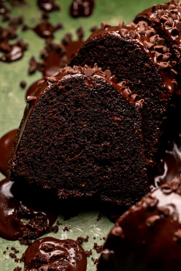 This Chocolate Zucchini Bundt Cake is insanely moist, so fudgy, and loaded with chocolate flavor! No one will even know there's 2 whole cups of shredded zucchini hiding inside! Delicious with chocolate glaze, but can easily be served with whipped cream or a dusting of powdered sugar instead!