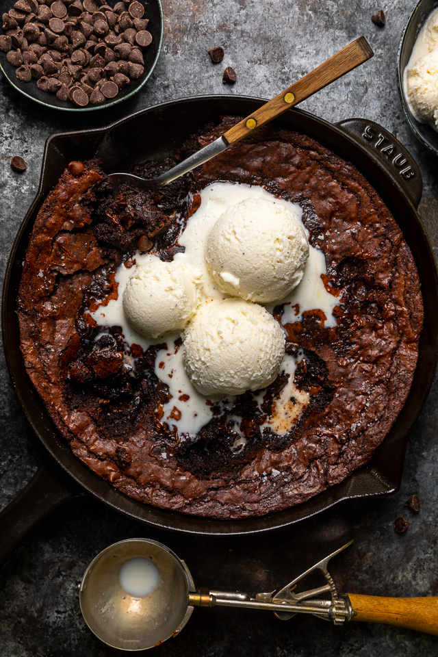 These Easy Skillet Brownies are gooey, fudgy, and so decadent! Made with cocoa powder, melted chocolate, and chocolate chips, these fudgy brownies are definitely for chocolate lovers only! Serve warm, with a few giant scoops of vanilla ice cream on top!
