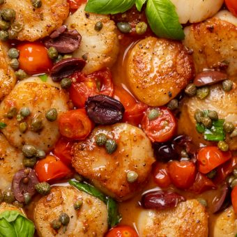 Looking for an easy and flavorful seafood dish? Look no further than these Pan Seared Scallops with Tomatoes, Olives, and Capers! Delicious on their own but insanely good over pasta or a bed of asparagus!