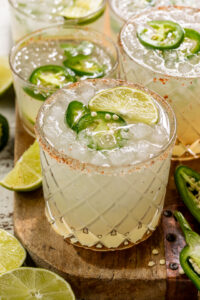 Say hello to the BEST Spicy Jalapeno Margarita your lips will ever meet! It's everything you love about a classic margarita, but with a spicy kick! Feel free to double the spice if you really want to suffer, or reduce it for a more mild marg!