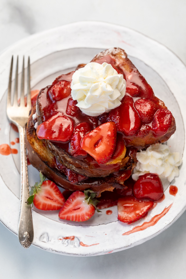 Strawberries and Cream French Toast features buttery slices of brioche bread, fresh strawberries, and whipped cream! A fancy restaurant-quality recipe that's perfect for Easter, Mother's Day, or a bridal shower brunch! This recipe can easily be doubled if you're serving a large crowd!