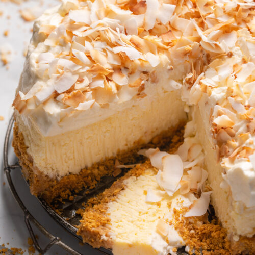 This Creamy Coconut Cheesecake is made with coconut milk, coconut extract, and shredded coconut, so you know it's loaded with refreshing coconut flavor! The crunchy graham cracker crust is the perfect contrast to the creamy filling and fluffy whipped cream topping. A must try for coconut lovers!