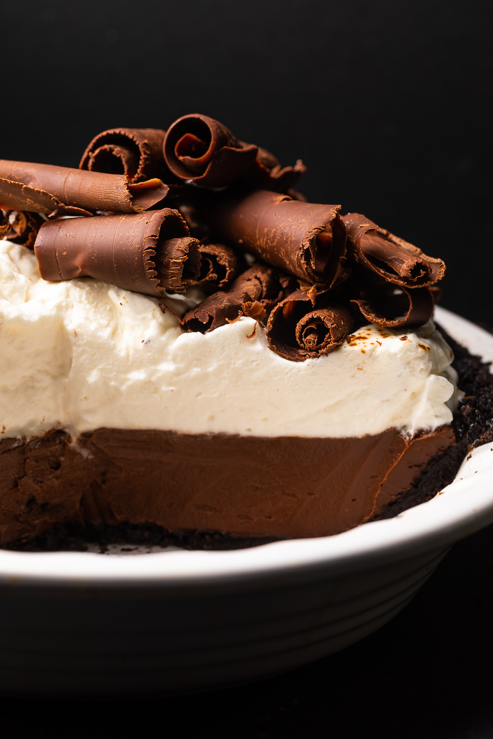 This over-the-top Espresso Chocolate Pudding Pie is a chocolate lovers dream come true! Featuring a chocolate cookie crust, silky smooth espresso chocolate pudding, and a luscious layer of freshly whipped cream, this recipe is always a crowd-pleaser! Top with chocolate curls for a show stopping presentation!